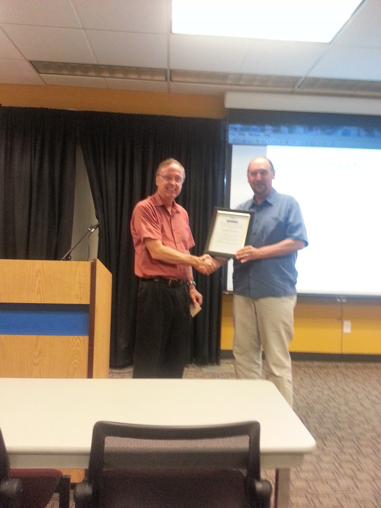 Dr. Gayn Winters receives certificate from Computer Society Chairman Bill Grist