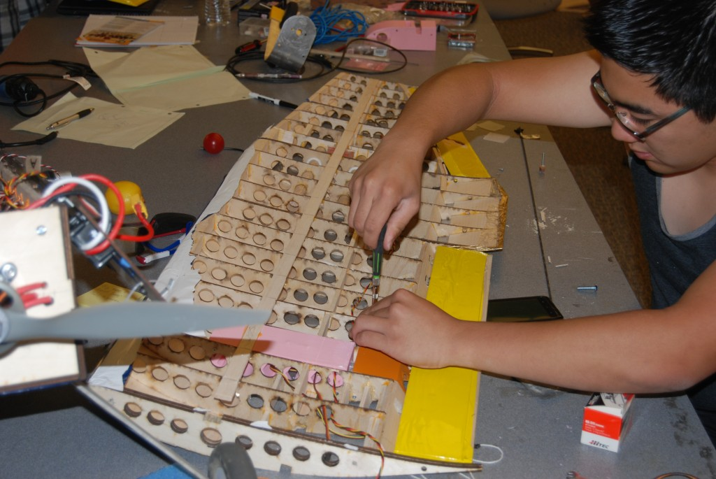 Wiring through the balsa wood wings for aerodynmic control
